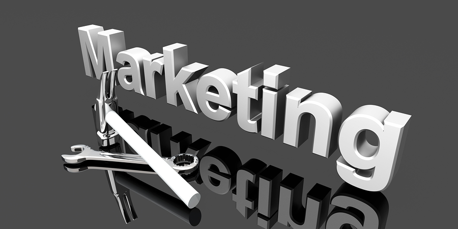 great marketing copy in 5 easy steps for small business - image of metallic word marketing with tools